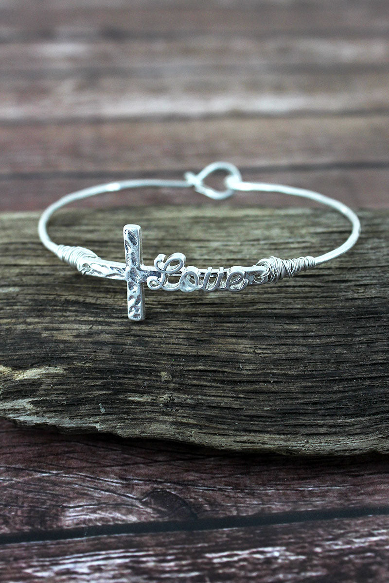 Crave Worn Silvertone 'Love' Script Cross Bangle