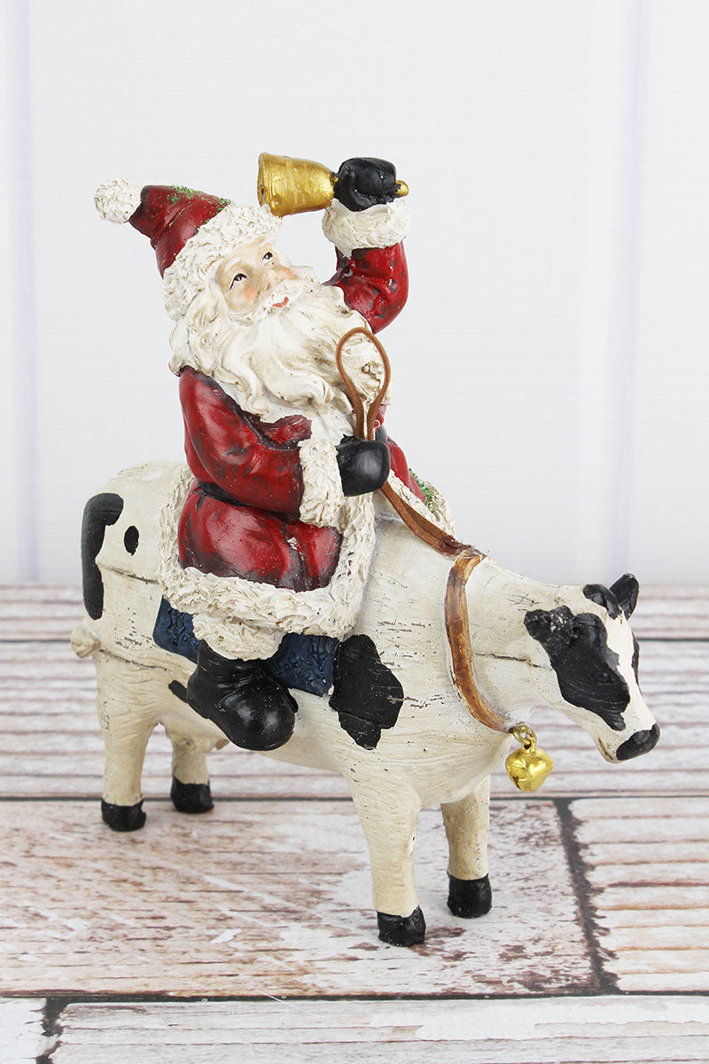 7.5 x 6.75 Kris Kringle Cow Resin Figurine