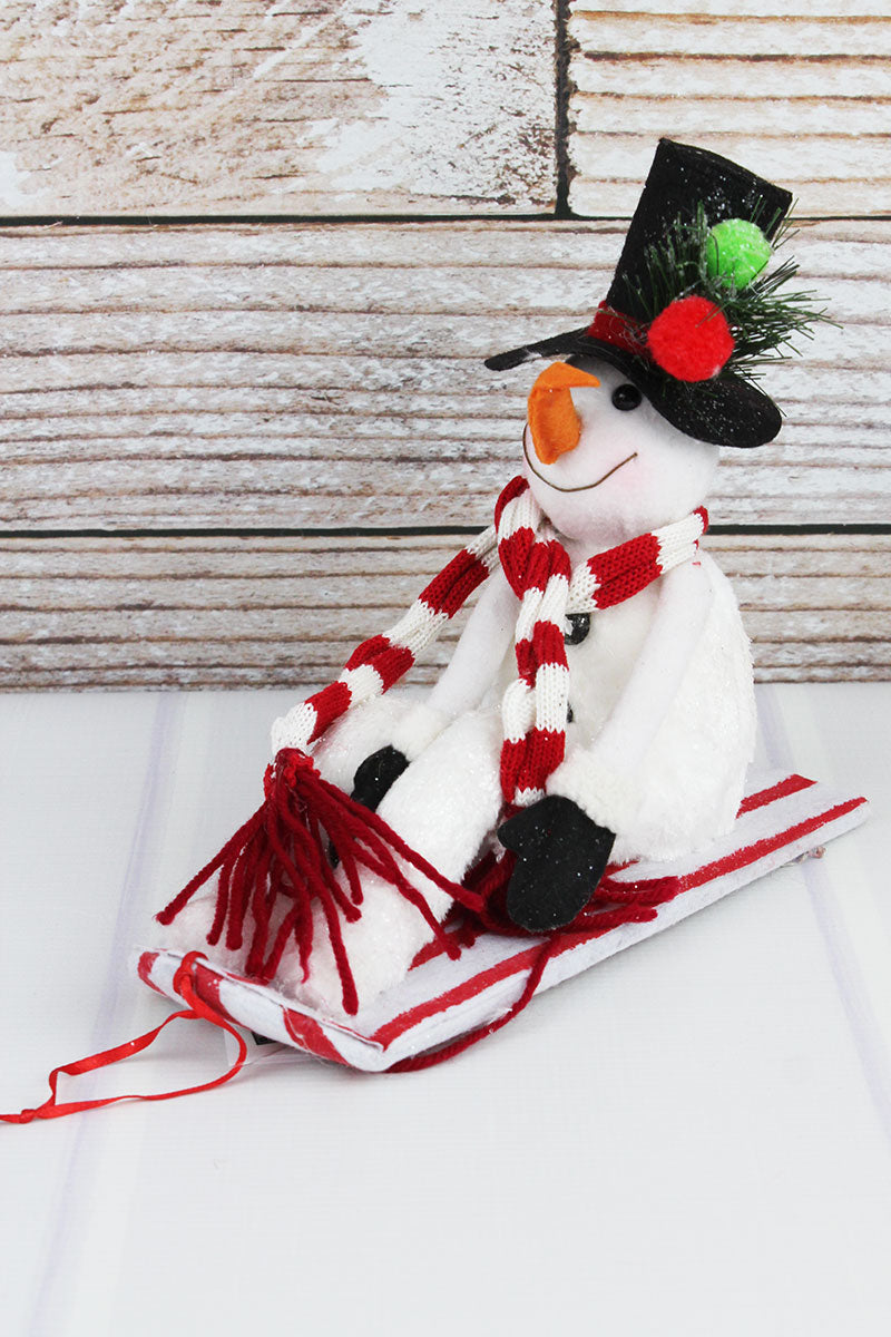 8.5 x 10 Plush Glitter Snowman Sitting on Sled Decor