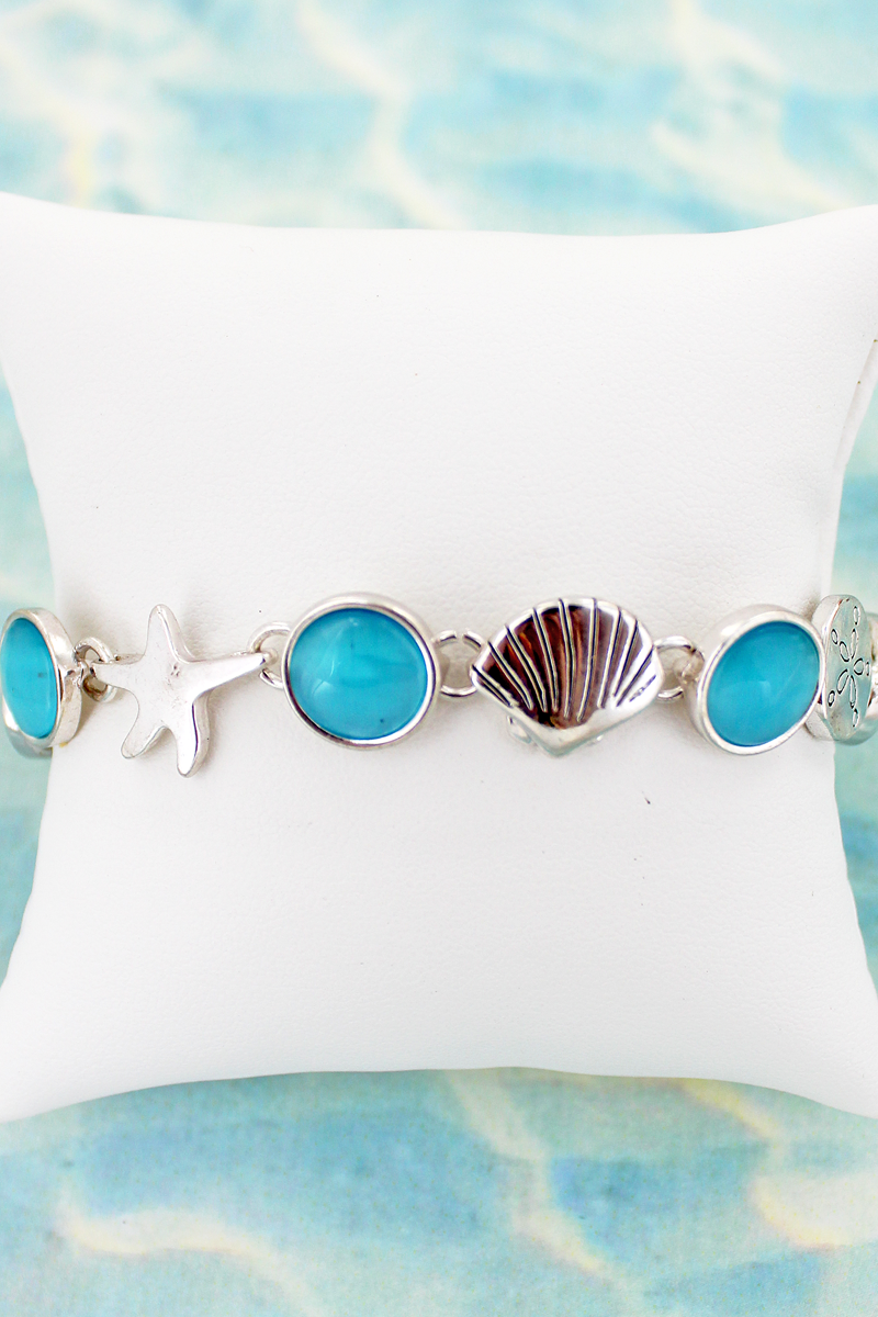 Silvertone Sea Life and Blue Disk Magnetic Bracelet