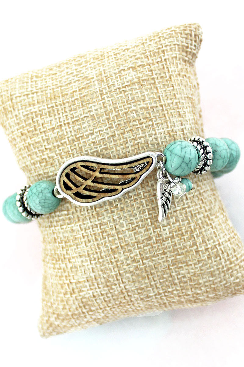 SALE! Worn Silvertone and Turquoise Wooden Wing Stretch Bracelet