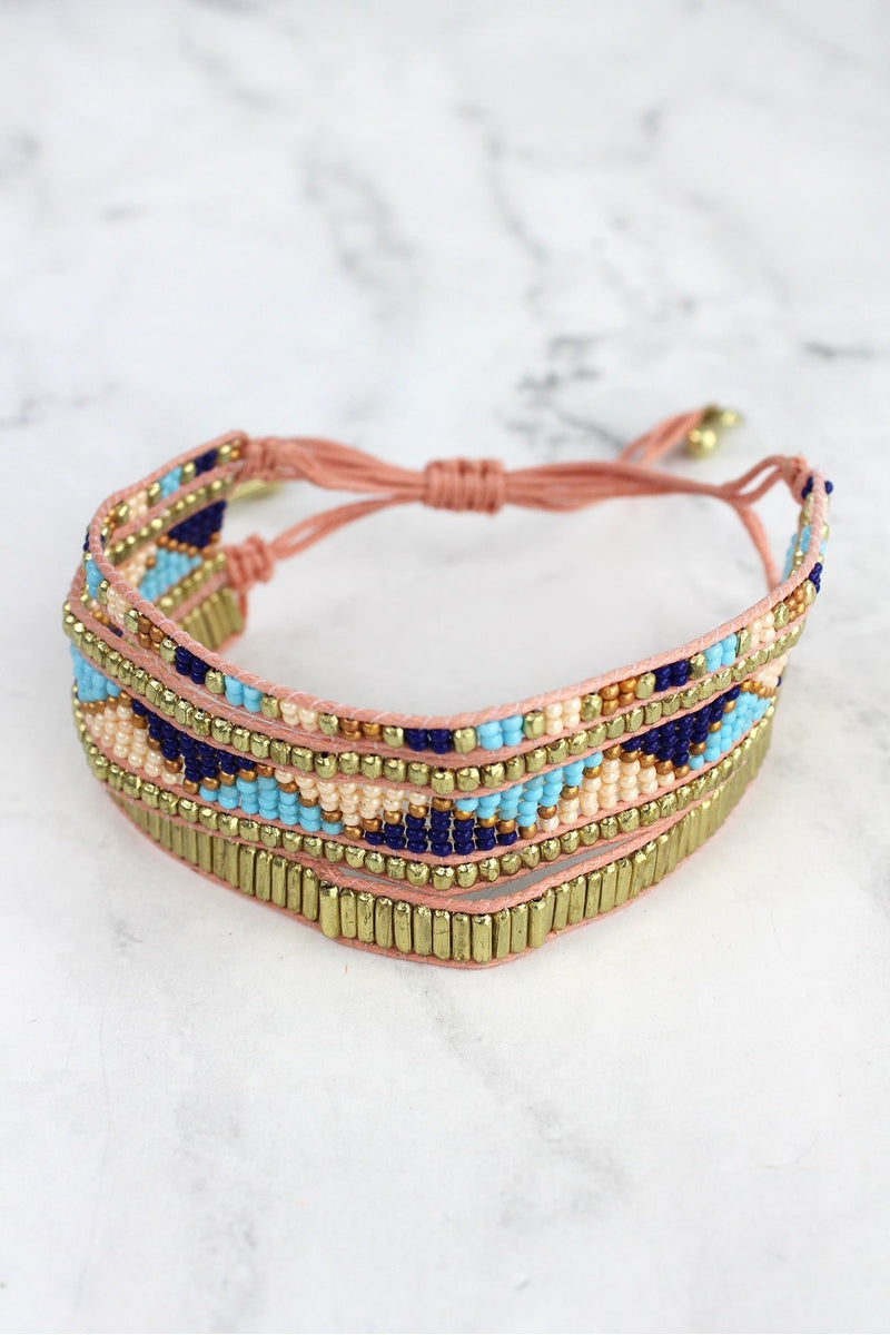 Multi-Color Triangle Seed Bead Shredded Peach Cord Bracelet