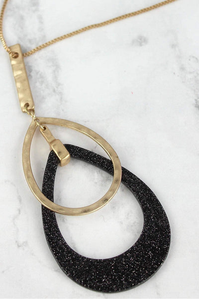 Worn Goldtone and Black Glitter Double Teardrop Necklace