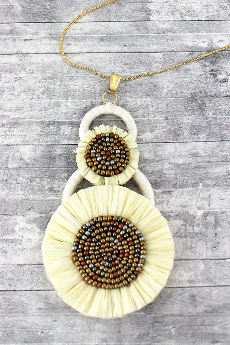 Ivory Seed Beaded Raffia Pendant Necklace