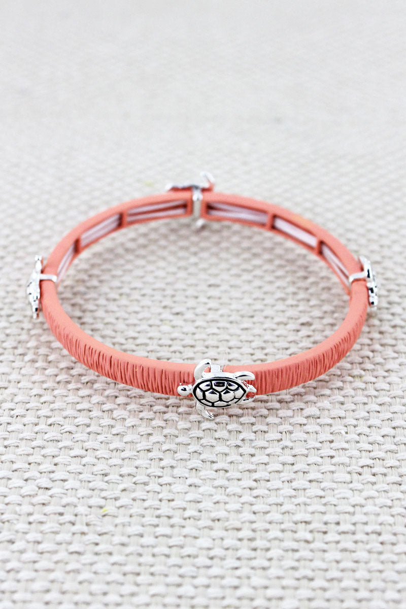 Coral and Silvertone Turtle Stretch Bracelet