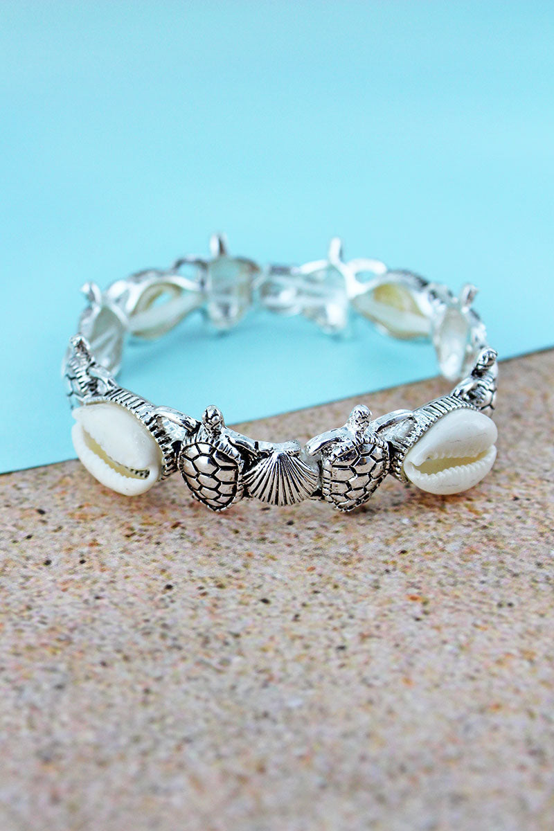 Cowrie Shell Accented Silvertone Turtle and Shell Stretch Bracelet