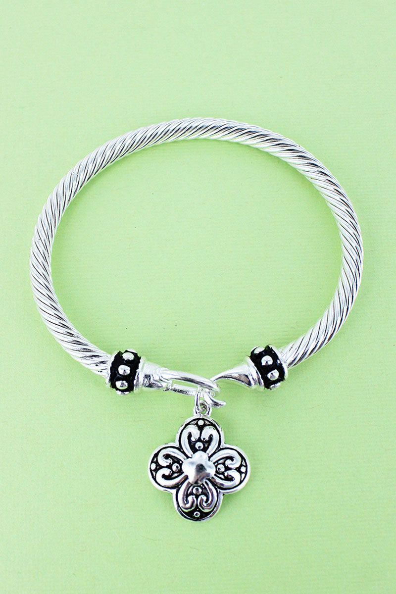 Silvertone Quatrefoil Charm Twisted Bangle Bracelet