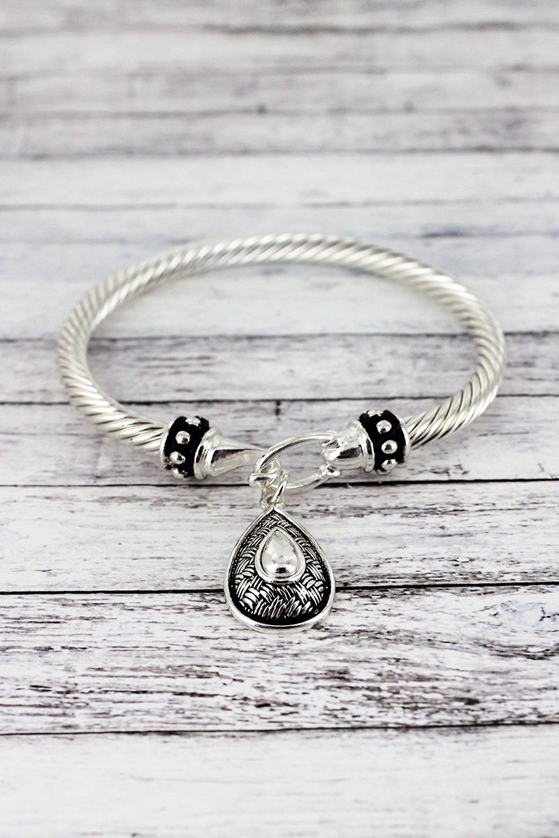 Silvertone Teardrop Charm Twisted Bangle Bracelet