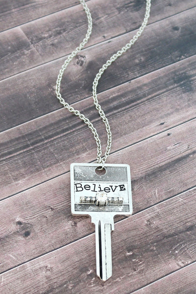 Burnished Silvertone and Crystal 'Believe' Key Necklace