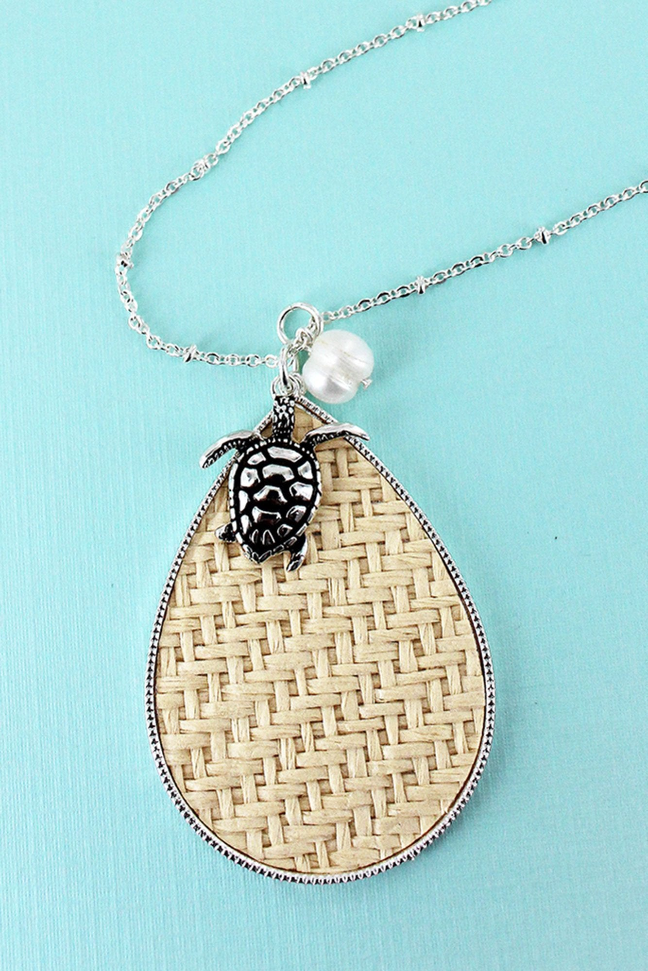 Ivory Rattan Teardrop with Silvertone Turtle Pendant Necklace
