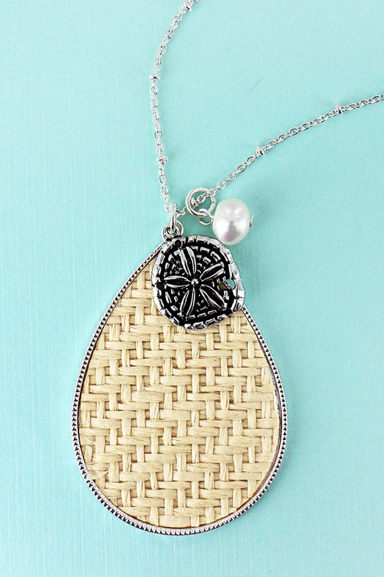 Ivory Rattan Teardrop with Silvertone Sand Dollar Pendant Necklace