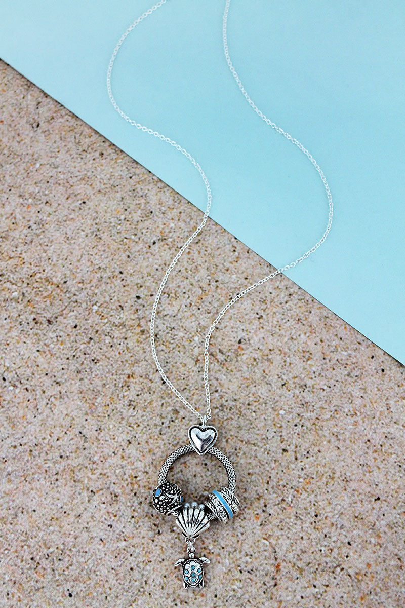Silvertone and Blue Turtle Beaded Ring Pendant Necklace