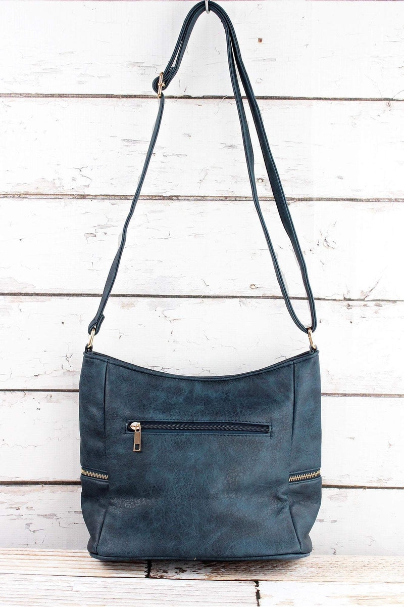 NGIL Navy Faux Leather Double Tassel Zip Pocket Crossbody Bag