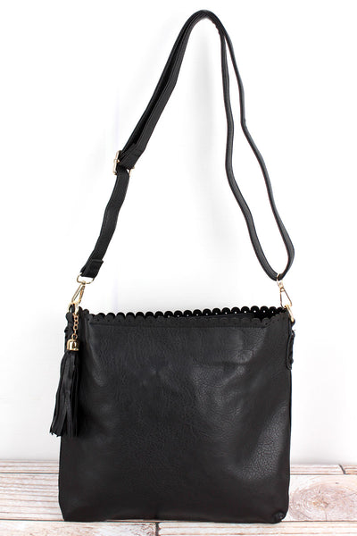 NGIL Black Faux Leather Scalloped Top Tassel Crossbody Tote