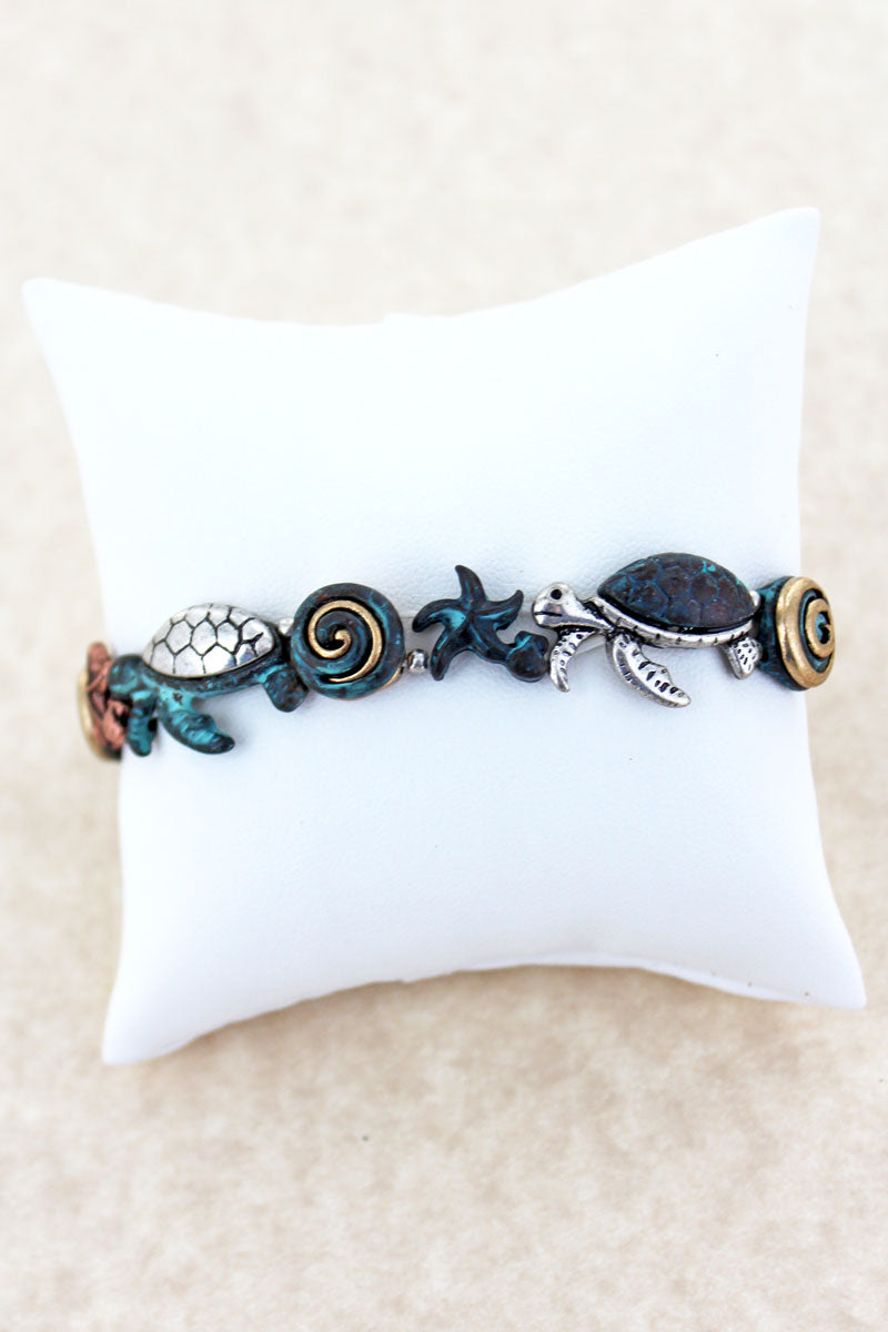 Burnished Tri-Tone and Patina Turtle Swirl Stretch Bracelet
