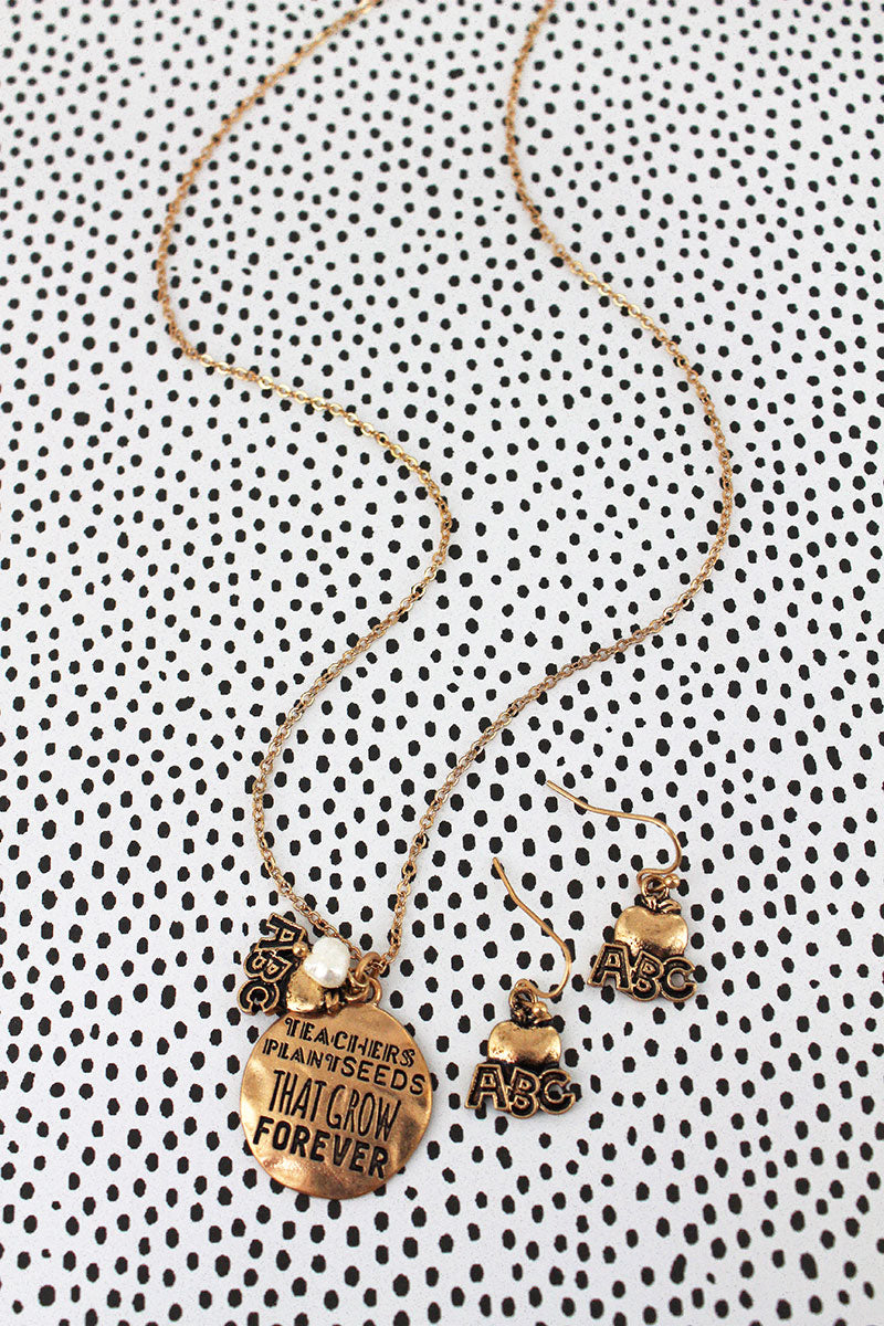 Worn Goldtone 'Teachers Plant Seeds' Necklace and Earring Set