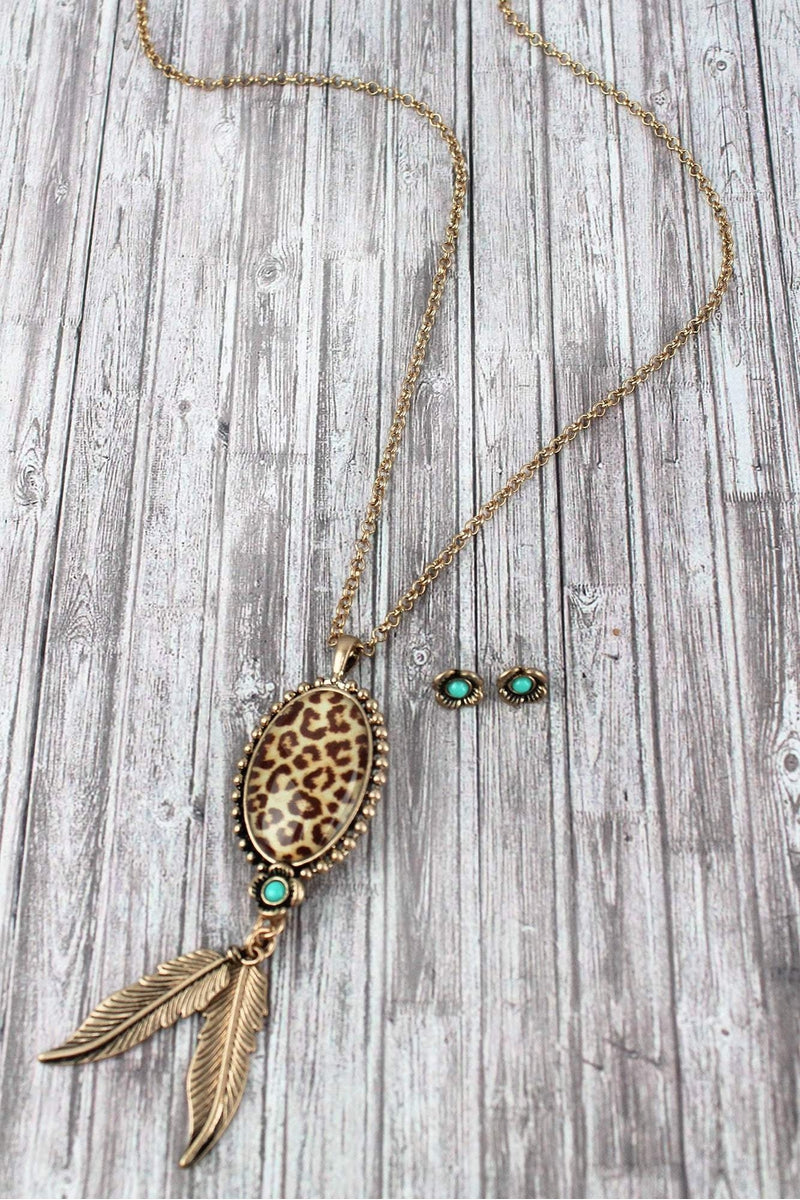Worn Goldtone and Leopard Pendant Necklace and Earring Set