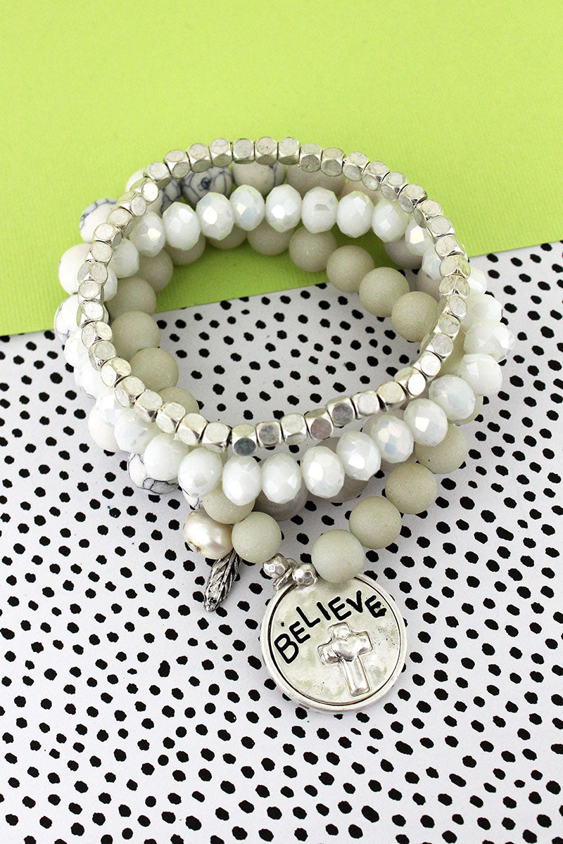 Worn Silvertone 'Believe' and Feather Charm White Beaded Bracelet Set