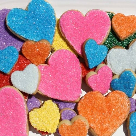 Rainbow heart shaped cookies. Swirled with white chocolate and rainbow sprinkles. Super Love cookies