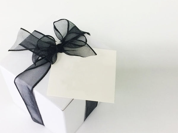Gift box of cookies. Sugar cookie swirled with chocolate in white box with black bow. Classic cookie gift.