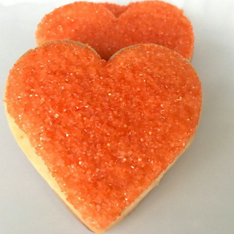 Orange heart shaped sugar cookie