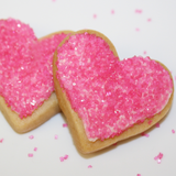 Pink heart shaped sugar cookies guittard white chocolate and pink sprinkles gift wrapped