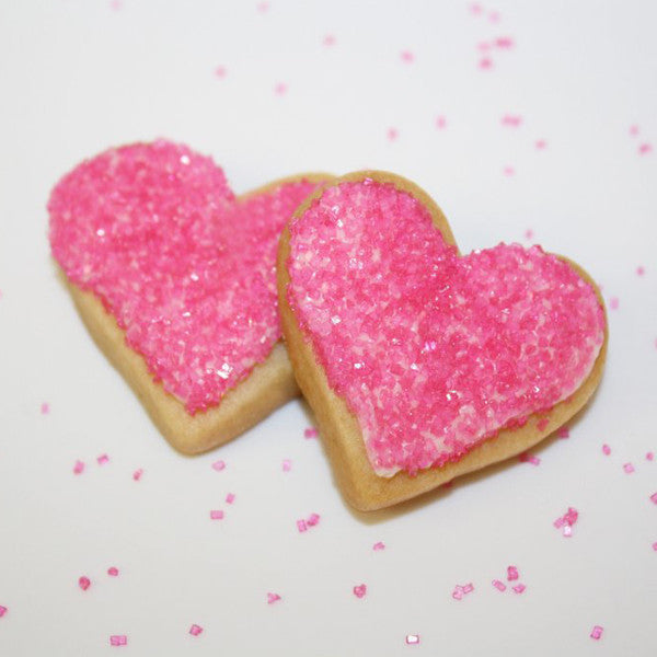 Heart shaped cookies pink sprinkles. Sugar cookies with pink sprinkles