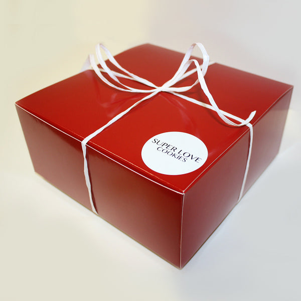 Red gift box packed with cookies and personalized note