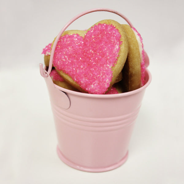 pink heart shaped sugar cookie favors in pink bucket