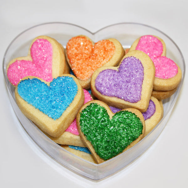 heart shaped sugar cookie gift with rainbow sprinkles
