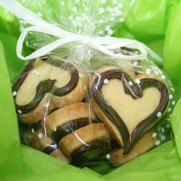 heart shaped sugar cookies with dark chocolate and gift wrapped