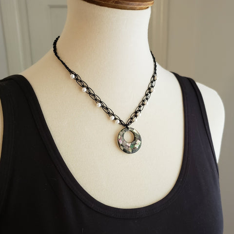 mother of pearl inlay necklace on black linen