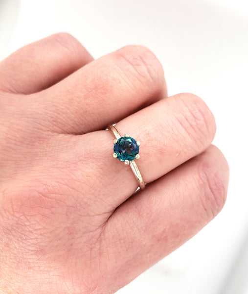 silver ring with blue topaz gemstone