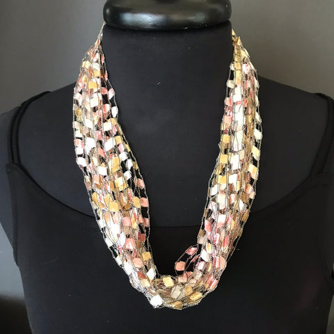 gold tone ribbon necklace by Gini Steele