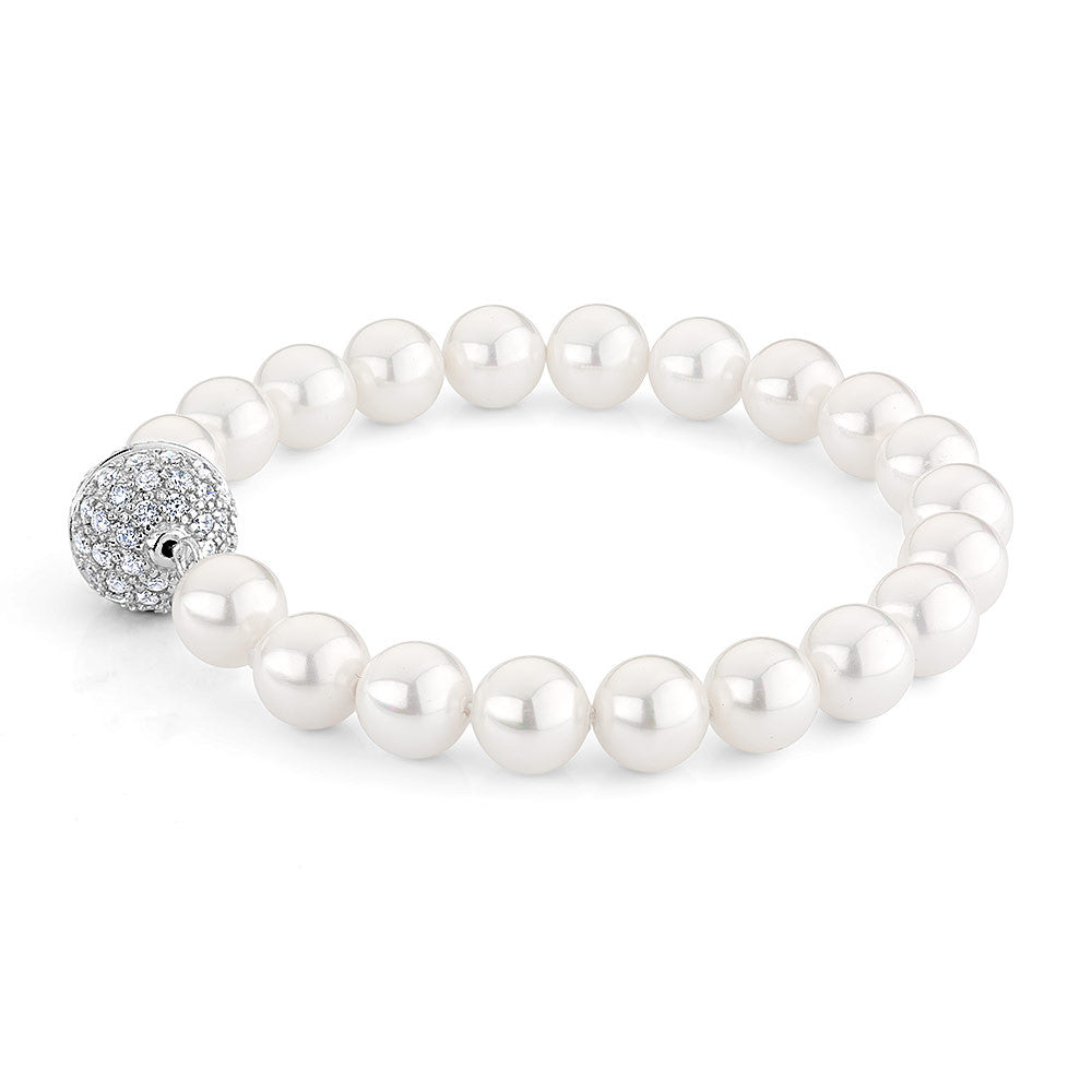Sterling silver bracelet set with Signity cz and mother of pearls beads.