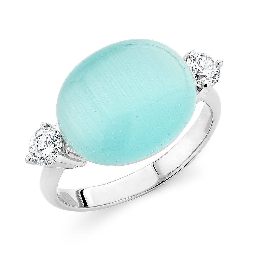 Sterling silver ring set with a cabochon baby blue cats eye stone and  Signity CZ , rhodium plated