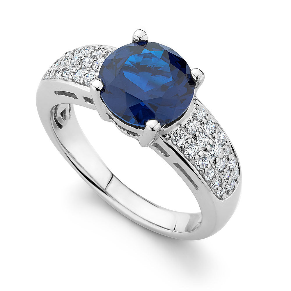 Sterling silver ring set with a faceted blue Sapphire Signity CZ , rhodium plated