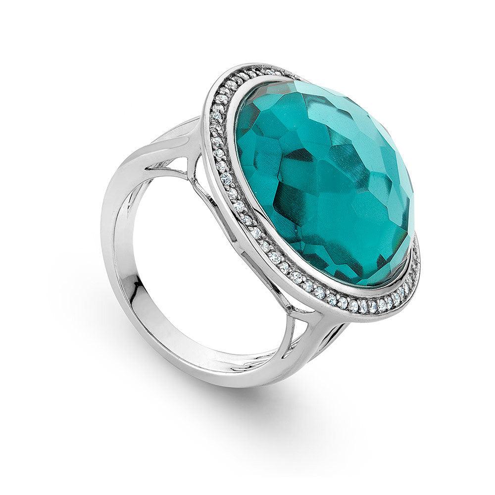 Sterling Silver ring set with Signity CZ centered with a round faceted Turquoise Cz