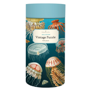 Cavallini round puzzle box with a blue lid and blue ombre case, adorned with vintage jellyfish illustrations.