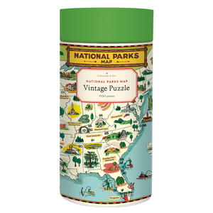Cavallini round puzzle box with a green lid and cream case, adorned with a bright national parks illustration.