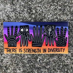 "A sticker which says ""there is strength in diversity"" with a multicolor background and several hands"