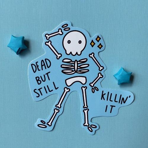 a sticker featuring a skeleton with sparkles.
