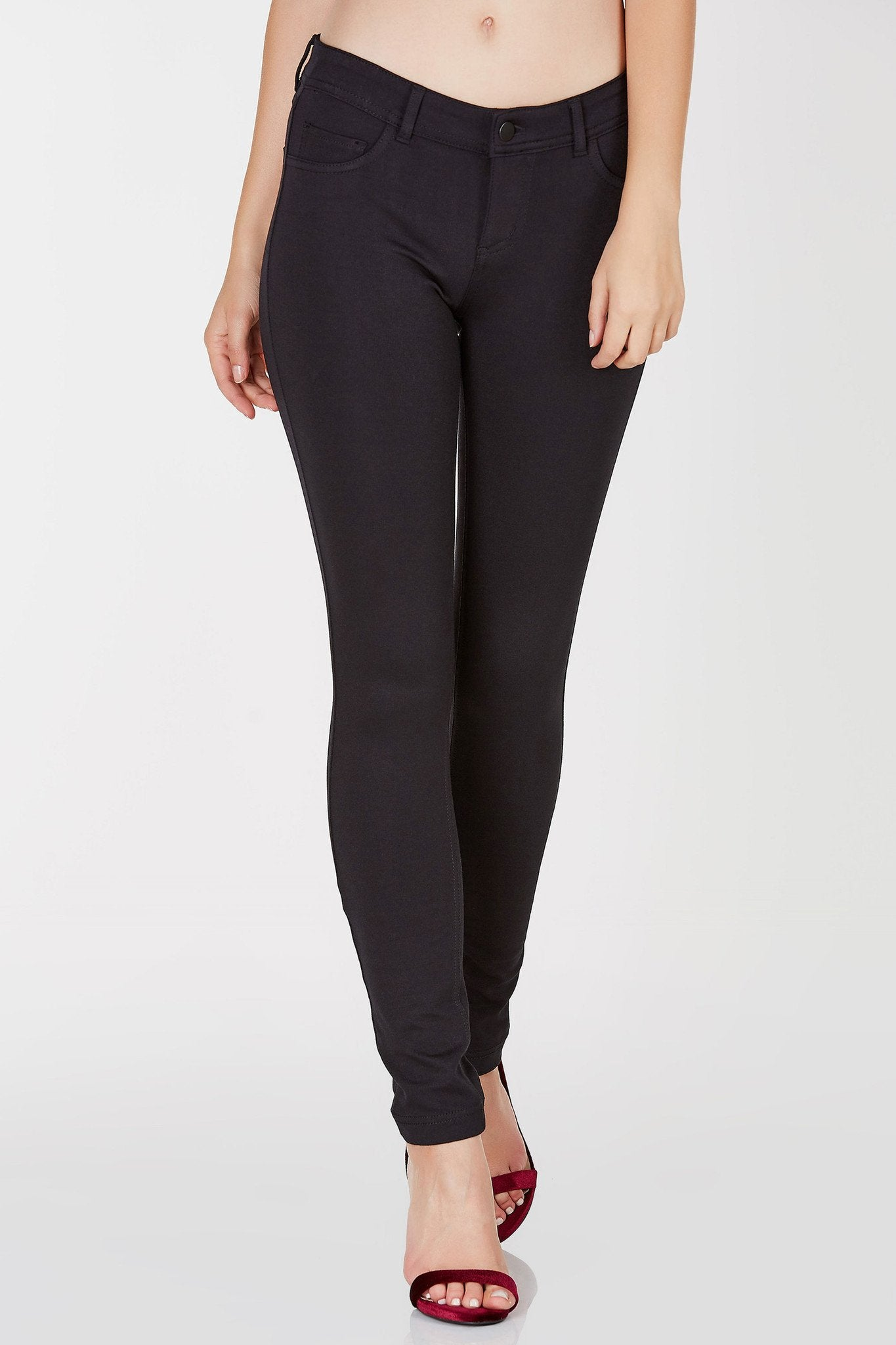An awesome pair of stretchy jeggings. These jeggings have two functional pockets on the back and a single zipper and button for fit and closure.