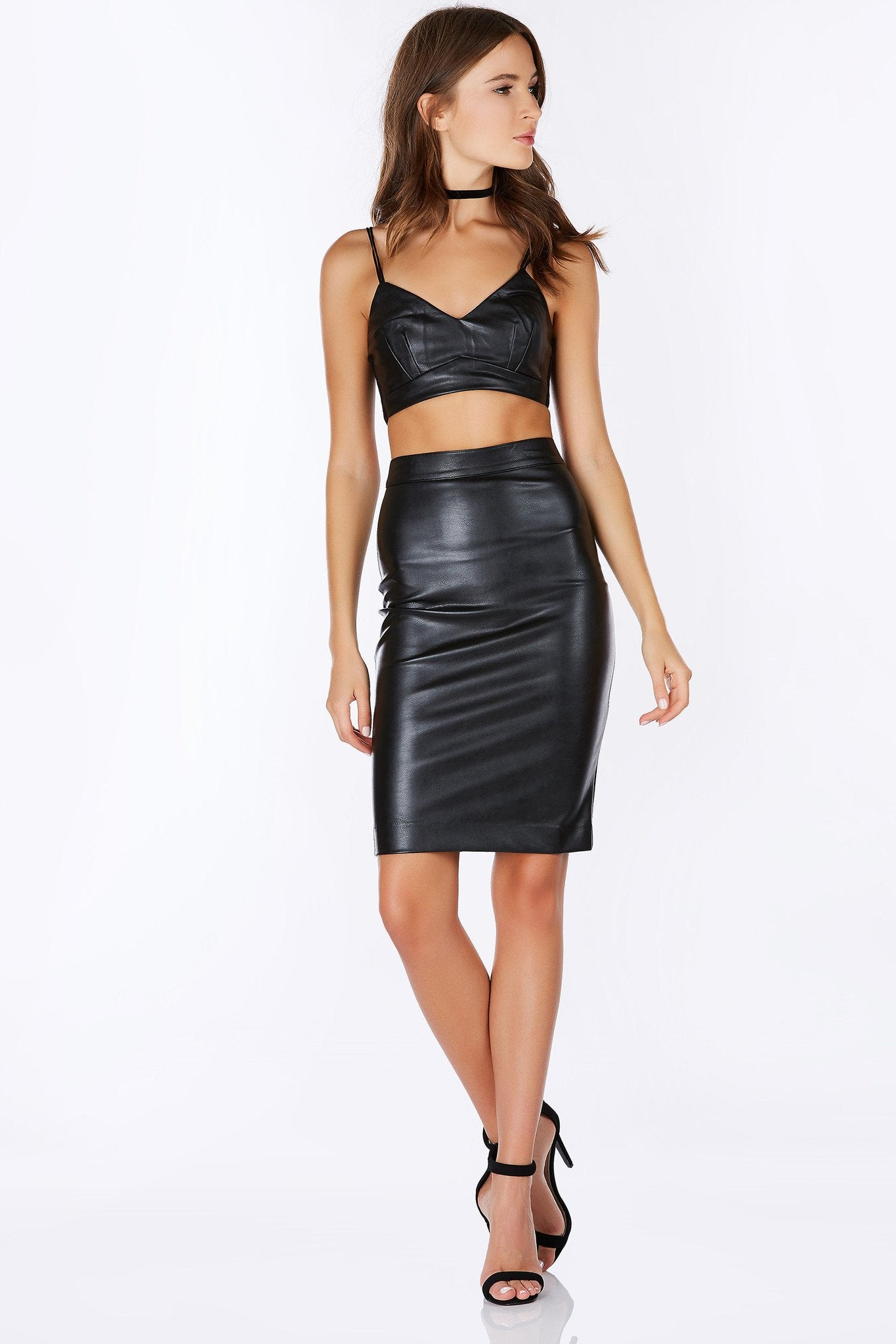 "A sexy and flirtatious faux leather bralette that kinda screams ""BAD GIRL"". This top is lined on the inside and has two straps for cute detailing. Has a single zipper on the back for closure. Match this crop top with the matching Trouble Maker Midi Skirt to complete the look."