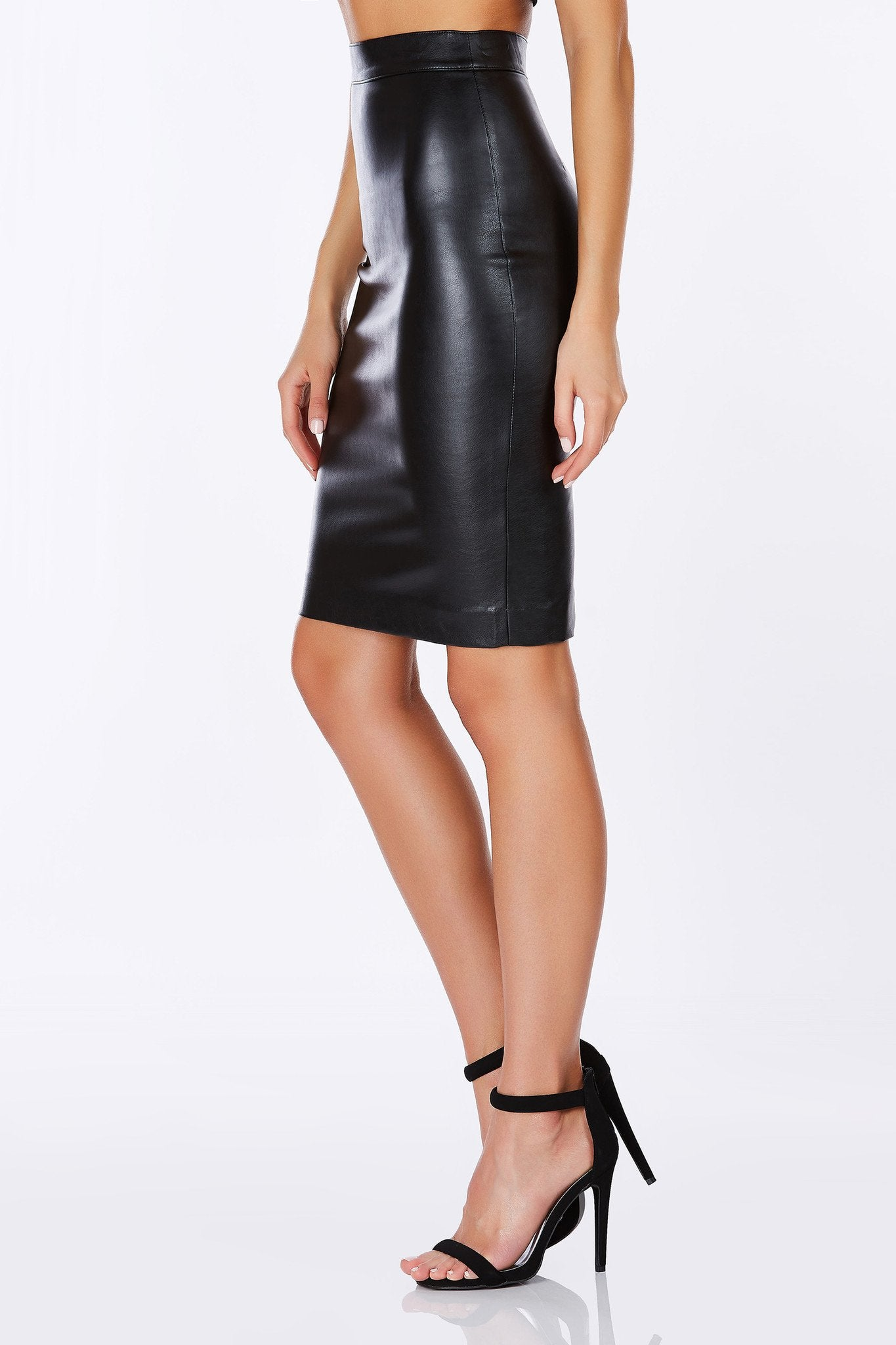 A super sexy faux leather midi skirt. This skirt is high waisted and has a single zipper on the back for closure. Pair this skirt with the matching Trouble Maker Crop Top. Looks hot with a gold chain and red lips!