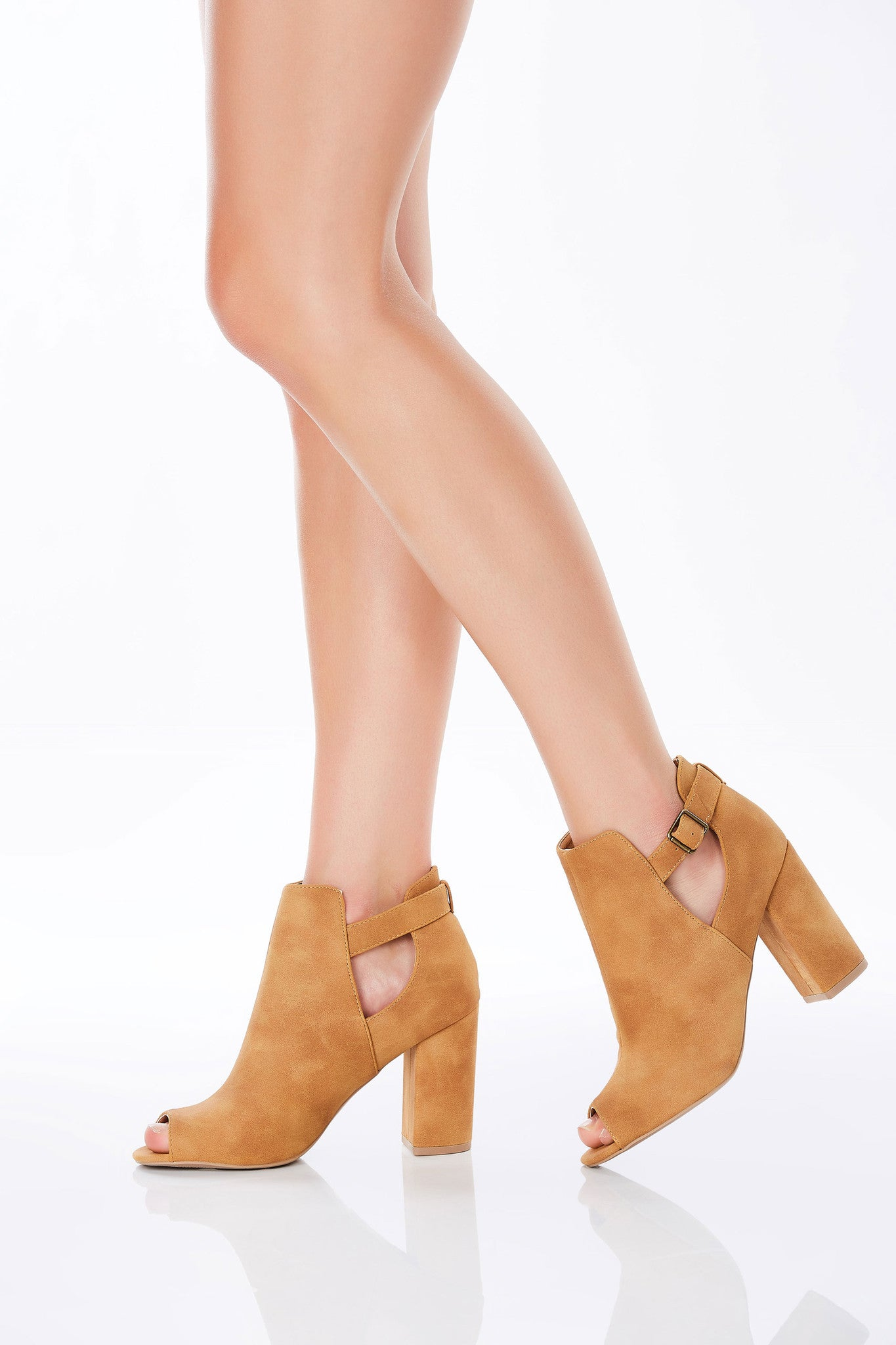 An amazing pair of faux suede booties with great block heels for comfortable wear. Features peep toe and chic cut outs with a classic buckled ankle strap. Pair with distressed denims to upgrade any casual outfit!
