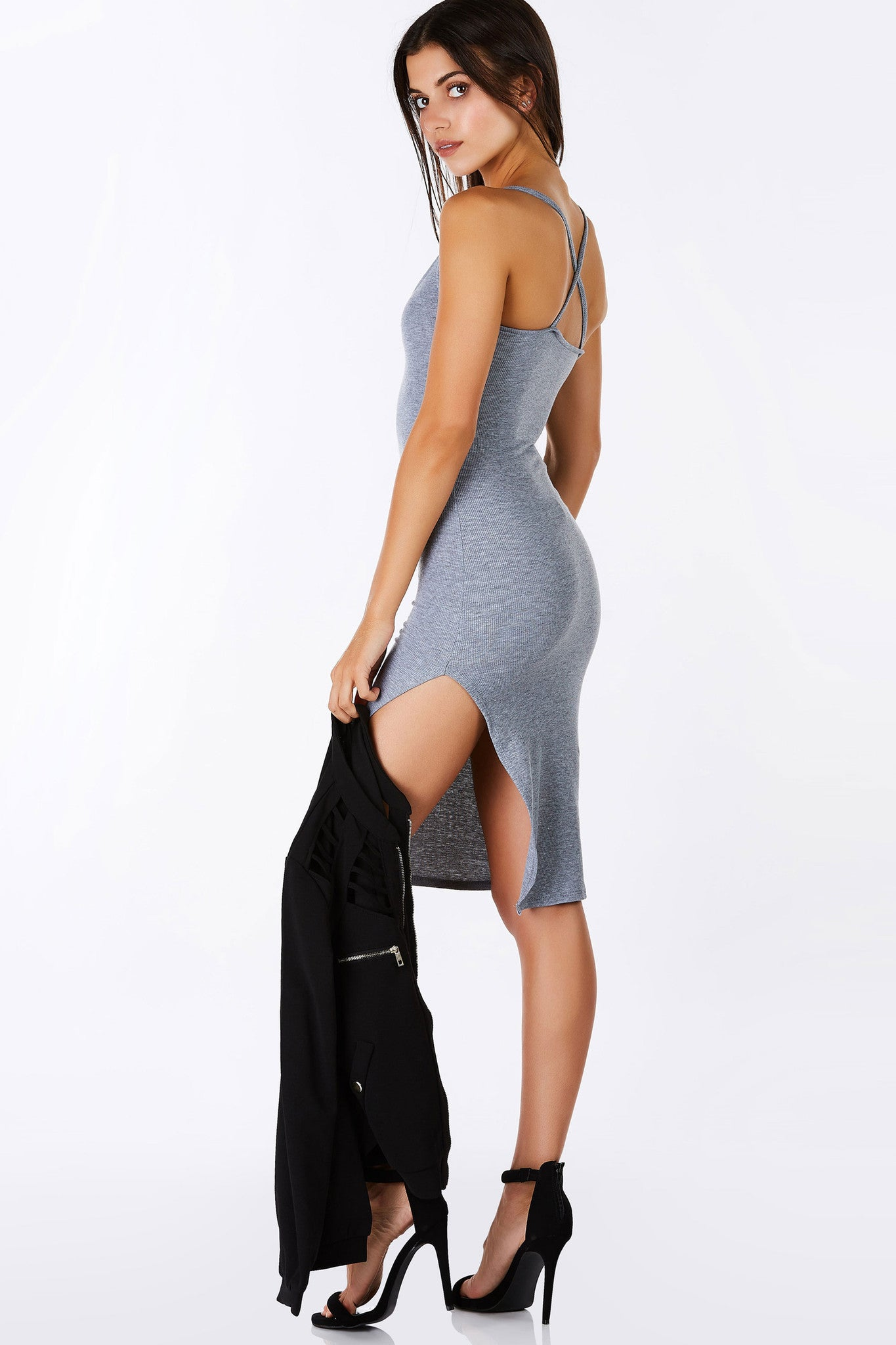 This ribbed midi dress is absolute perfection! Perfectm bodycon fit to accencuate your curves. Thin spaghetti straps, criss crossing at the back for added detail. Single slit on one side brings a flirty, sexy finish. Easy to dress up or down, the choice is yours!