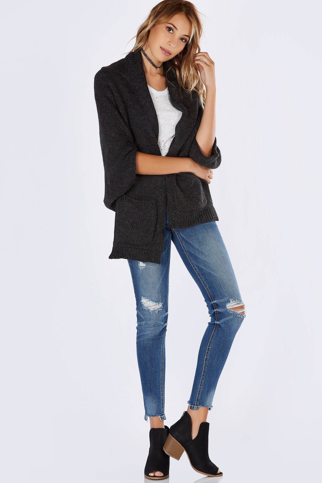 A super cozy cardigan perfect for the upcoming Season! Warm draped collar with an open front. Batwing sleeves with side slits for an unexpected twist. Functional pockets to keep your personal belongings safe. Throw on over a basic cami and denim jeans!