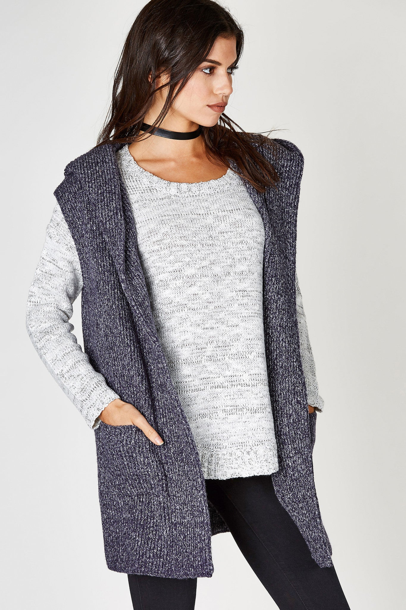 An amazing knitted vest, perfect for transitioning into Fall! Great blend of materials for a soft, stretchy finish. Two front pockets to keep your hands cozy with a clean open front. Hood attached to keep your head warm while keeping your lookin' stylish!