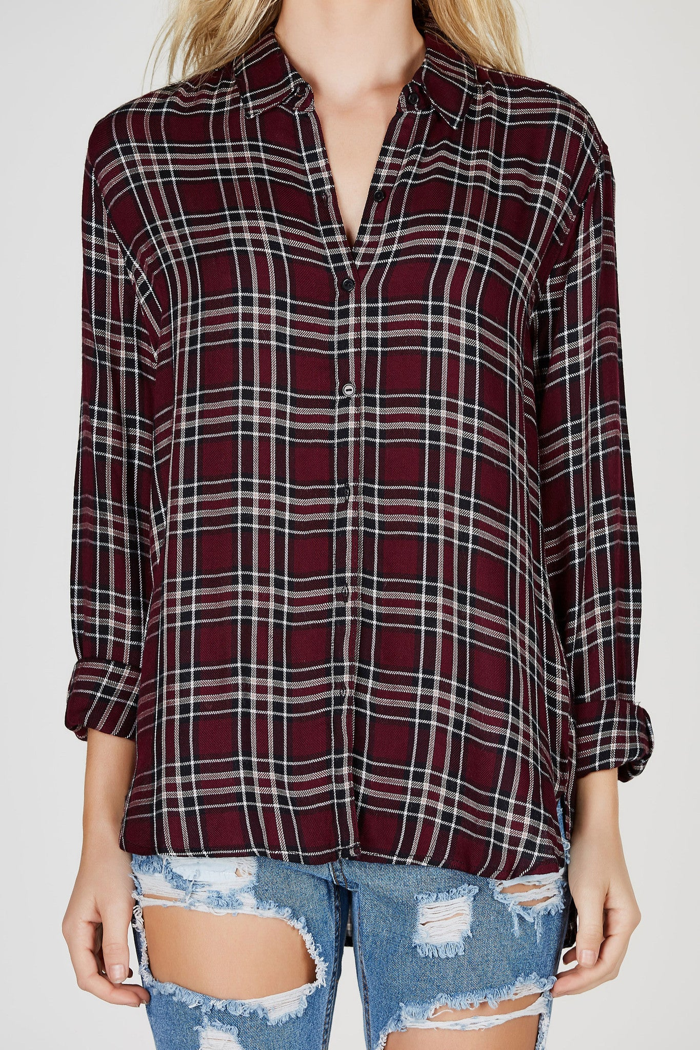 This soft lightweight flannel will soon become your go-to piece for Fall! Classic plaid pattern throughout with a soft rounded hem. Tuck it into your favorite jeans for an effortless daytime look!